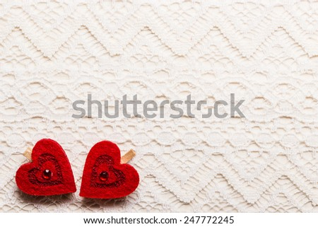 Valentines day wedding, invitation or greeting card. Red decorative hearts love symbol on white cloth lace background - stock photo