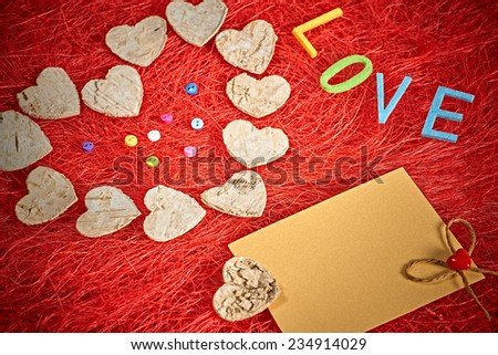 Valentines day. Word Love. Hearts made of bark and Love note on Red sisal - stock photo