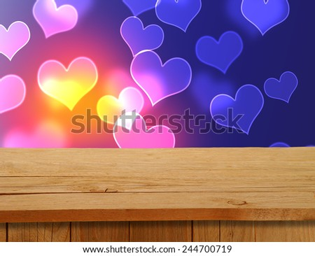 Valentines Design. Empty wooden deck table over hearts motif. Ready for product montage  - stock photo