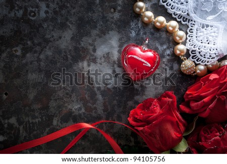 valentines greeting card with red roses and red heart on dark background - stock photo