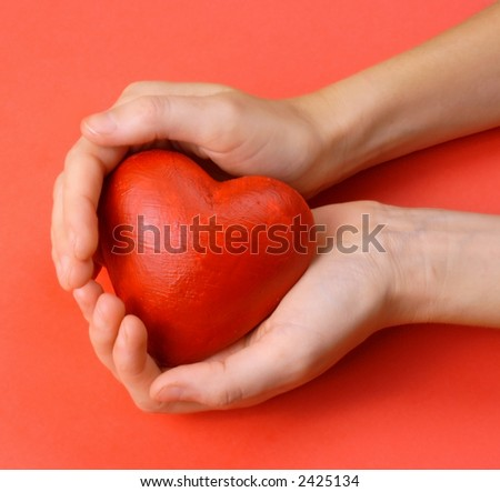 Valentines - red heart in hands