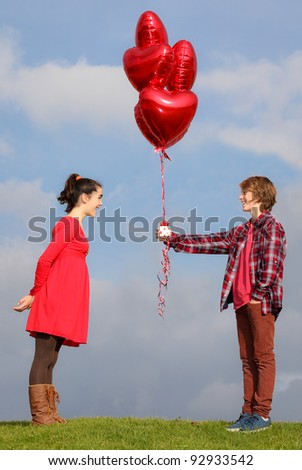 valentines teen couple with hearts - stock photo