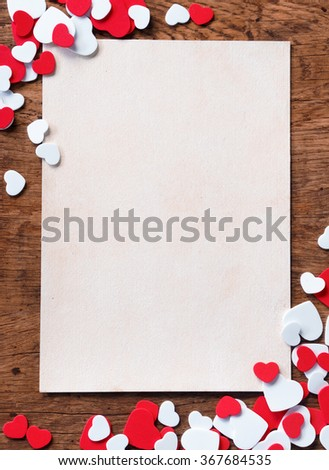 Valentines white background with heap of small hearts on wooden background. Copy space for your text
