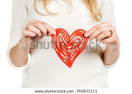 Valentines woman holding heart smiling happy. Love concept with happy caucasian female model isolated on white background.