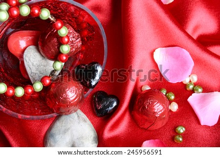 Valetine day hearts in a bowl with jewelery - stock photo