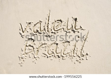 Valeu Brazil thank you message in Portuguese handwriting in sand - stock photo