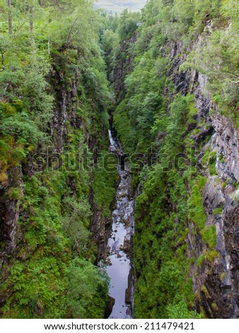 Valey with waterfall in the mountains, Scotland - stock photo