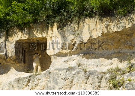 VALKENBURG - AUGUST 10: The entrance to the town caves of Valkenburg in the Netherlands is marked by a statue of a miner hewn in the chalk sediments the caves are made of, on August 10, 2012. - stock photo