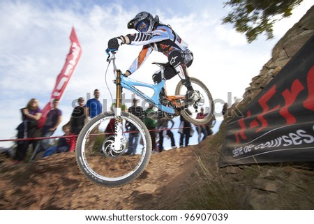 """VALL D'UIXO, SPAIN - MARCH 04: An unidentified athlete competes in the """"Nissan European Downhill Cup"""" on March 04, 2012, Vall d'Uixo, Spain - stock photo"""