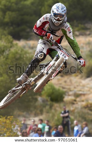 """VALL D'UIXO, SPAIN - MARCH 04: Enrique Jimenez competes in the """"Nissan European Downhill Cup"""" on March 04, 2012, Vall d'Uixo, Spain - stock photo"""