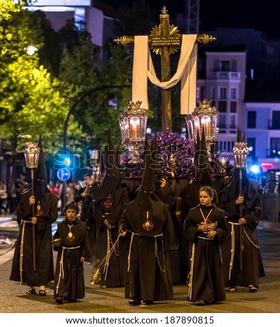 VALLADOLID, SPAIN -Â?Â? APRIL 17, 2014: Nazarenos carrying cross sculpture in the religious processions during Holy Week on Good Thursday Night, on April 17, 2014 in Valladolid, Spain. - stock photo