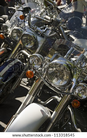VALLADOLID, SPAIN - SEPTEMBER 2, 2012: A row of motorcycle headlights at a meeting of vintage cars in Valladolid, Spain on September 2, 2012 - stock photo