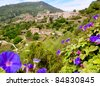 Valldemossa from Majorca view from purple Ipomea flowers foreground - stock photo