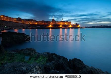 Valletta and Manoel Island at dusk - stock photo