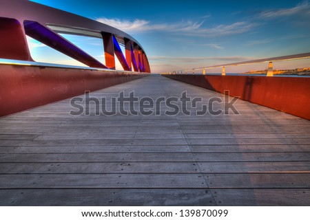 Valletta Breakwater Bridge at dusk on a clear day. Valletta is the 2018 European capital city of culture. - stock photo