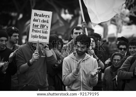 VALLETTA, MALTA - DEC 17 - Demonstrators during a rally held by Facebook group Legalize It Malta, in favour of the decriminalisation and legalisation of cannabis and hemp, on 17 December 2011 - stock photo