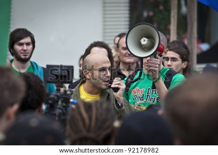 VALLETTA, MALTA - DEC 17 - Event organiser David Caruana delivers his message during a rally in favour of the decriminalisation and legalisation of cannabis and hemp, on 17 December 2011 - stock photo