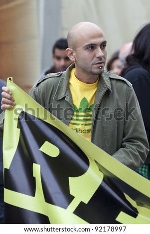VALLETTA, MALTA - DEC 17 - Event organiser David Caruana during a rally in favour of the decriminalisation and legalisation of cannabis and hemp, on 17 December 2011 - stock photo