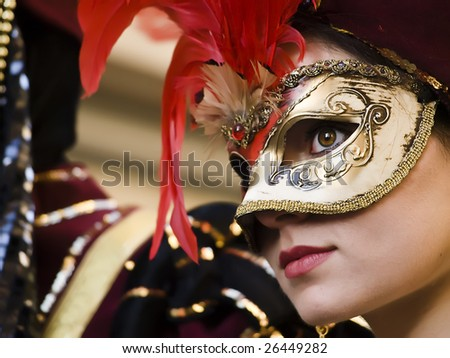 VALLETTA, MALTA - Feb 21st 2009 - Woman wearing beautiful Venetian style mask and costume at the International Carnival of Malta 2009