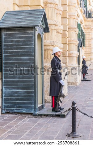 VALLETTA, MALTA - Feb 5th 2015:Sentry on guard prior to the changing of the guard which is a ceremony that takes place at 10AM each day at the Presidential Palace in  St Georges Sq in Valletta