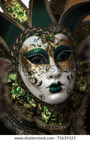 VALLETTA, MALTA - MAR 06 - Woman wearing Venetian mask during the International Carnival of Malta on 6th March 2011