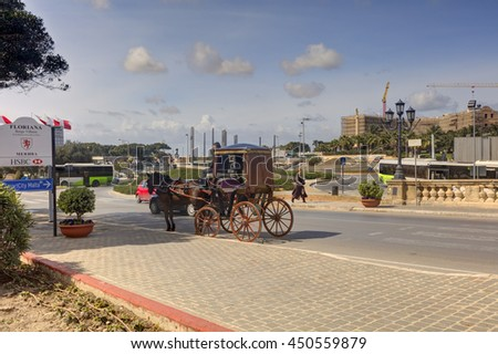 VALLETTA, MALTA - MARCH 10, 2015: Historic street of Valletta city with a horse coach waiting there