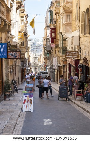 Valletta, Malta - May 30: People and tourists at the streets of Valleta, Malta at May 30, 2014 - stock photo