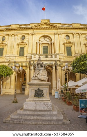 VALLETTA MALTA - MAY 2016: Statue of Queen Victoria, Republic Square, Valletta, Malta, Europe. With the limestone National Library of Malta in background