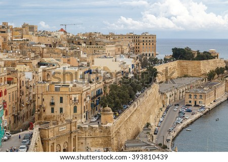 VALLETTA, MALTA - OCTOBER 30, 2015 : General view of Valletta, Malta island with seascape, port and historical limestone buildings from medieval times. - stock photo