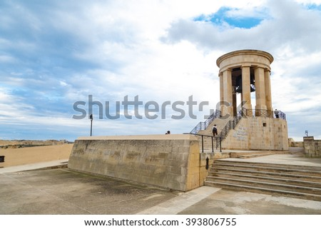 VALLETTA, MALTA - OCTOBER 30, 2015 : View of the bell tower of Siege Bell Memorial in Valletta, Malta, on cloudy blue sky background.