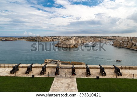 VALLETTA, MALTA - OCTOBER 30, 2015 : View of the gardens of Lascaris War Rooms in Valletta, Malta, with seascape on cloudy blue sky background. - stock photo