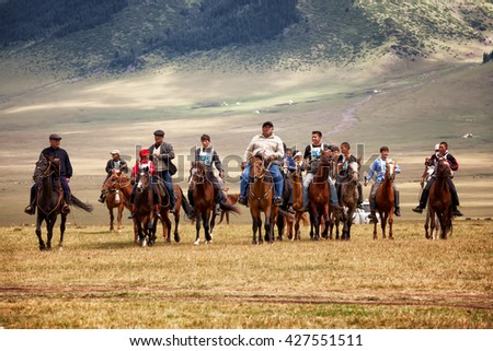 VALLEY ASSY, KAZAKHSTAN - Aug 12, 2009 : A traditional national nomad long-distance horse riding competition Bayga in action on  valley Assy, Almaty region, Kazakhstan.