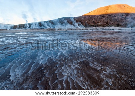 Valley Geysers at El Tatio, northern Chile at Sunrise, Atacama Region, close to the Bolivian border - stock photo