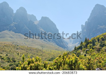 Valley in misty mountains. Shot in Hottentots-Holland Mountains nature reserve, near Somerset West/Cape Town, Western Cape, South Africa. - stock photo