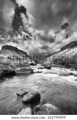Valley in the Drakensberg mountain in South Africa with water stream artistic conversion - stock photo