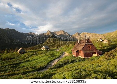 Valley in the Polish Tatra Mountains at sunrise. - stock photo