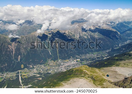 Valley of Chamonix from the summit of the Aiguille du Midi, French Alps. - stock photo