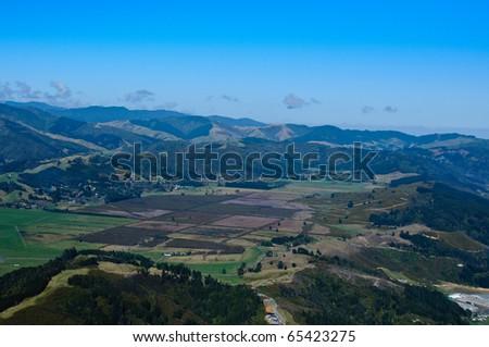 Valley of farm land near Wellington, New Zealand - stock photo