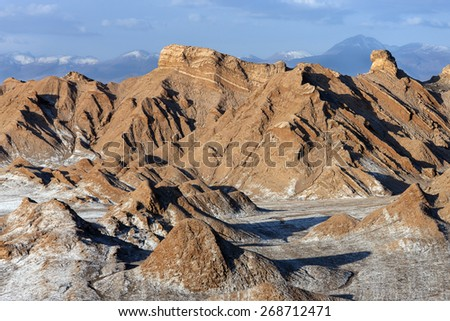 Valley of the Moon (Valle de Luna) in the Atacama Desert in northern Chile. The white areas are deposits of salt.  - stock photo