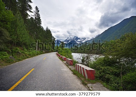 valley road in beside river  - stock photo