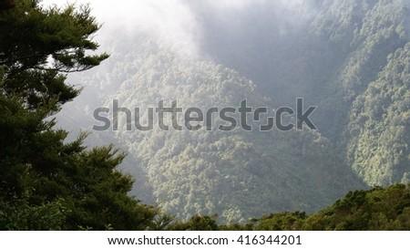 Valley view through a haze  - stock photo