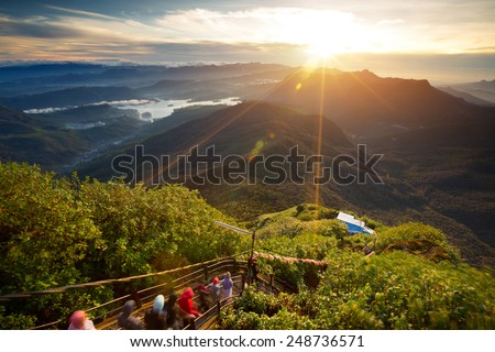 Valley view with villages and mountains at sunrise. View from Adam's peak, Sri Lanka - stock photo