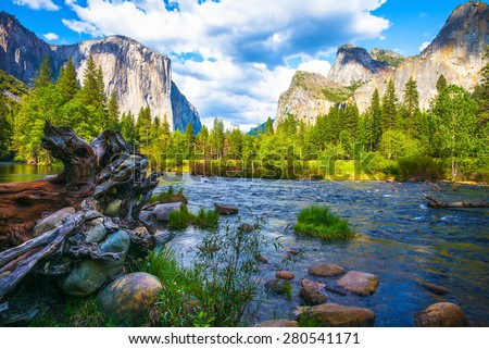 Valley View Yosemite National Park, California, USA.  A fallen tree and rocks on the Merced River. - stock photo