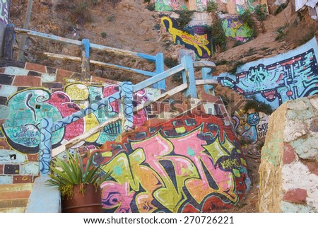 VALPARAISO, CHILE - APRIL 16, 2015: Colourfully decorated path leading up a hillside in the UNESCO World Heritage port city of Valparaiso, Chile. - stock photo