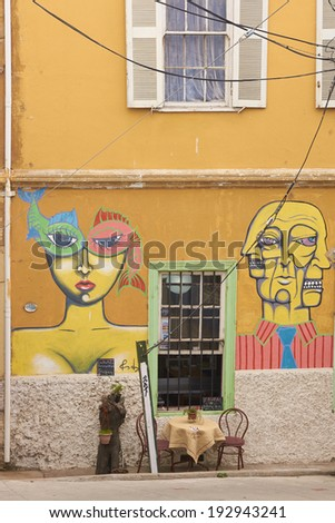 VALPARAISO, CHILE - MAY 13, 2014: Colourful murals decorating the wall of a house  in the world heritage city of Valparaiso in Chile