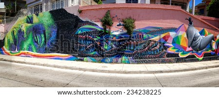 """VALPARAISO; CHILE- OCTOBER  29,  2014 :Graffiti with a dreaming person as subject  on  a wall of the art quarter  in """"Valparaiso"""", Chile. Valparaiso is part of the """"Unesco"""" world heritage - stock photo"""