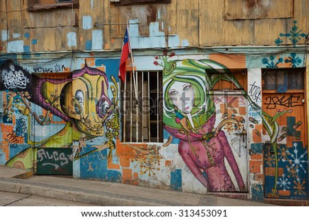 VALPARAISO, CHILE - SEPTEMBER 04, 2015: Colourful street art decorating houses in the UNESCO World Heritage port city of Valparaiso in Chile.