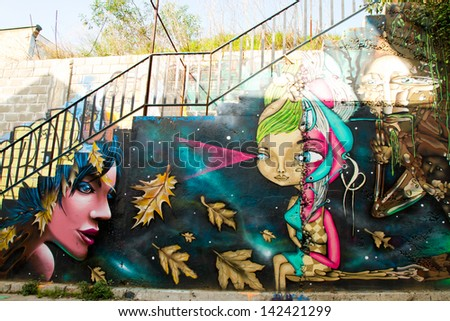 VALPARAISO - JUNE 09: Street art graffiti in  Concepcion and Alegre districts of the protected UNESCO World Heritage Site of Valparaiso on June 9, 2013 in Valparaiso, Chile - stock photo