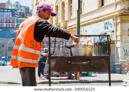 VALPARAISO - NOVEMBER 07: Street food seller in the protected UNESCO World Heritage Site of Valparaiso on November 7, 2015 in Valparaiso, Chile - stock photo