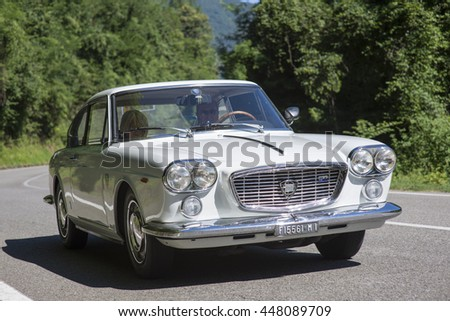 VALSESIA, ITALY - JULY 02, 2016: Classic car, A white Lancia Flavia traveling in the countryside